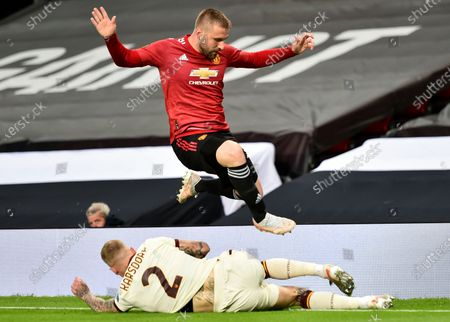 Luke Shaw (up) of Manchester United in action against Rick Karsdorp (down) of Roma during the UEFA Europa League semi final, first leg soccer match between Manchester United and AS Roma at Old Trafford in Manchester, Britain, 29 April 2021.