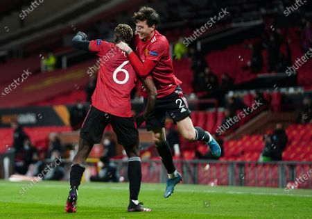 Manchester United's Paul Pogba, left, celebrates with Manchester United's Victor Lindelof after scoring his side's fifth goal during the Europa League semi final, first leg soccer match between Manchester United and Roma at Old Trafford in Manchester, England