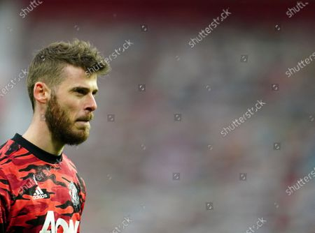 Manchester United's goalkeeper David de Gea looks on during warm up before the Europa League semi final, first leg soccer match between Manchester United and Roma at Old Trafford in Manchester, England