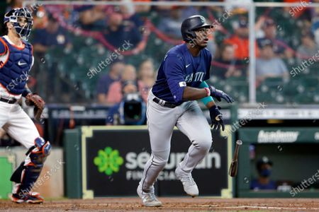 Seattle Mariners' Taylor Trammell, right, flips his bat as he watches his home run in front of Houston Astros catcher Jason Castro, left, during the third inning of a baseball game, in Houston