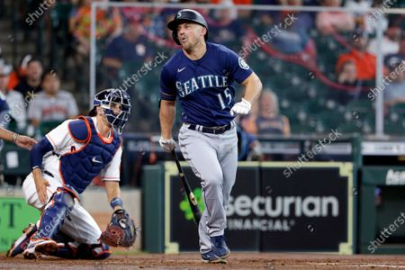Seattle Mariners third baseman Kyle Seager (15) reacts after fouling a ball off his right foot in front of Houston Astros catcher Jason Castro, left, during the third inning of a baseball game, in Houston
