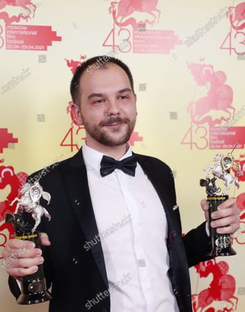 Romanian film director Andrei Hutuleac poses with the Main Prize trophy for the best film, Golden George, for his film 'Dogpoopgirl', at the closing ceremony of the 43st Moscow International Film Festival at the Rossiya Theatre in Moscow, Russia, 29 April 2021.
