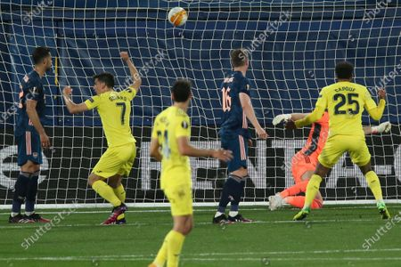 Villareal's Raul Albiol, not seen, scores his side's second goal during the Europa League semifinal first leg soccer match between Villarreal and Arsenal at the Estadio de la Ceramica stadium in Villarreal, Spain
