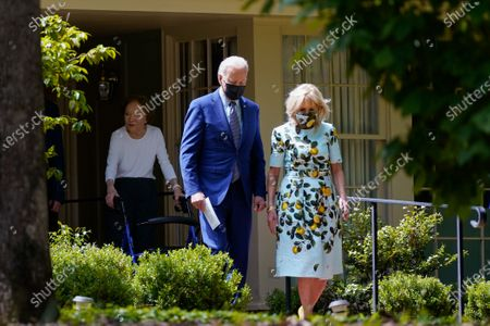 President Joe Biden and first lady Jill Biden walk with former first lady Rosalynn Carter as they leave the home of former President Jimmy Carter during a trip to mark Biden's 100th day in office, in Plains, Ga