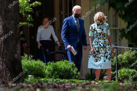 Stock Photo of Former first lady Rosalynn Carter looks on as President Joe Biden and first lady Jill Biden leave the home of former President Jimmy Carter during a trip to mark Biden's 100th day in office, in Plains, Ga