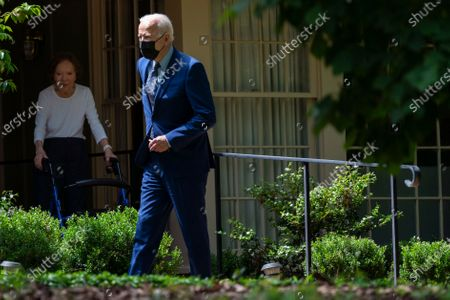 Stock Image of Former first lady Rosalynn Carter looks on as President Joe Biden leaves the home of former President Jimmy Carter during a trip to mark Biden's 100th day in office, in Plains, Ga