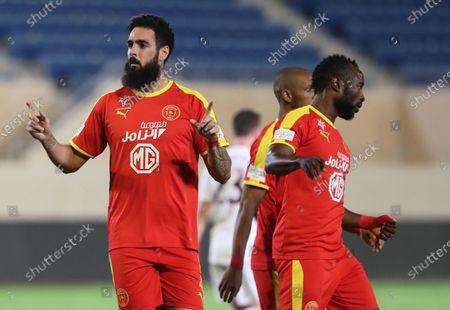 Al-Qadisiyah's Rhys Williams (L) celebrates after scoring a goal that was later disallowed during the Saudi Professional League soccer match between Al-Qadisiyah and Al-Faisaly at Prince Saud bin Jalawi Stadium in Khobar, Saudi Arabia, 29 April 2021.