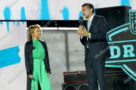 Legend Mike Golic is seen with host Colleen Wolfe during the 2nd round of the NFL football draft, in Cleveland