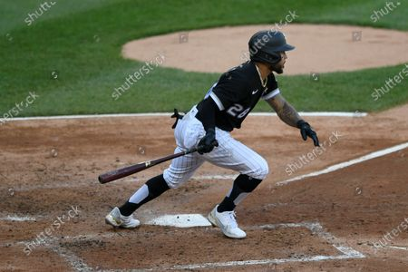 Chicago White Sox's Leury Garcia watches his two-RBI single during the fifth inning of the first baseball game of a doubleheader against the Detroit Tigers, in Chicago