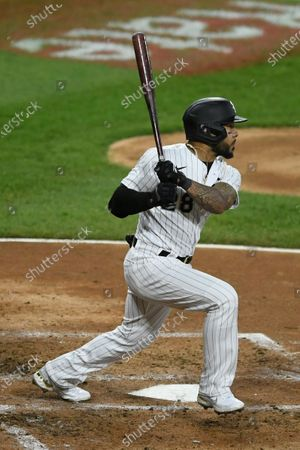 Chicago White Sox's Leury Garcia watches his RBI-single during the second inning of the second baseball game of a doubleheader against the Detroit Tigers, in Chicago