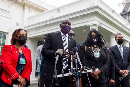 Stock Picture of Civil rights attorney Benjamin Crump (C), surrounded by family members of Black men who have been killed by police, speaks to the media about his push for a police reform bill outside the White House in Washington, DC, USA, 29 April 2021. Crump was at the White House to meet with Domestic Policy Advisor Susan Rice, following meetings with lawmakers on Capitol Hill.