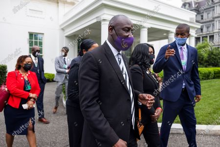 Civil rights attorney Benjamin Crump (C), surrounded by family members of Black men who have been killed by police, leaves the White House after speaking about his push for a police reform bill outside the White House in Washington, DC, USA, 29 April 2021. Crump was at the White House to meet with Domestic Policy Advisor Susan Rice, following meetings with lawmakers on Capitol Hill.