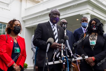 Civil rights attorney Benjamin Crump (C), surrounded by family members of Black men who have been killed by police, speaks to the media about his push for a police reform bill outside the White House in Washington, DC, USA, 29 April 2021. Crump was at the White House to meet with Domestic Policy Advisor Susan Rice, following meetings with lawmakers on Capitol Hill.