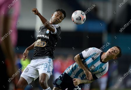 Nilson Loyola of Peru's Sporting Cristal, left, and Aníbal Moreno of Argentina's Racing Club battle for the ball during a Copa Libertadores soccer match at Presidente Peron stadium in Buenos Aires, Argentina