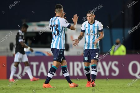 Juan Caceres (R) of Racing Club celebrates after scoring during the Copa Libertadores soccer match between Racing Club and Sporting Cristal at Presidente Peron stadium in Avellaneda, Argentina, 29 April 2021.