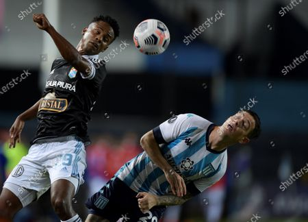 Anibal Moreno (R) of Racing Club in action against Nilson Loyola (L) of Sporting Cristal during the Copa Libertadores soccer match between Racing Club and Sporting Cristal at Presidente Peron Stadium in Avellaneda, Argentina, 29 April 2021.