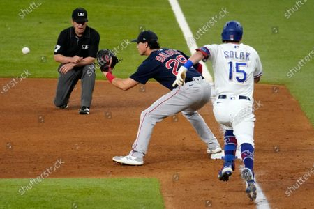 Stock Picture of Boston Red Sox first baseman Bobby Dalbec (29) reaches out for the throw from second baseman Marwin Gonzalez for the out on a grounder by Texas Rangers' Nick Solak (15) during the fifth inning of a baseball game in Arlington, Texas, . Umpire Ron Kulpa watches