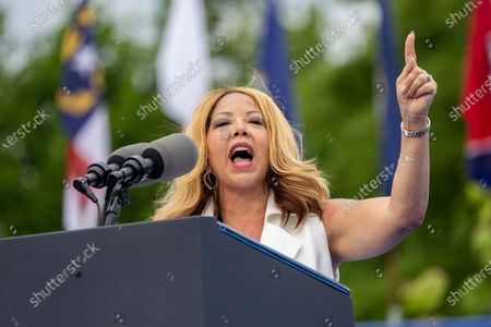 Congresswoman Lucy McBath (D-GA) speaks at a drive in rally for President Biden celebrating his 100 days in office, in Duluth, Georgia on April 29th, 2021.