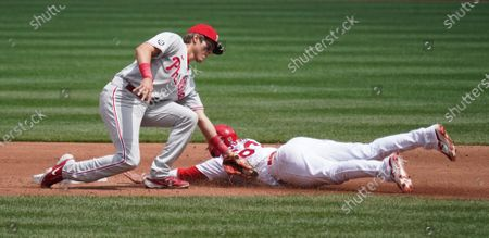 St. Louis Cardinals Edmundo Sosa is tagged out trying to steal second base by Philadelphia Phillies Nick Mason in the third inning at Busch Stadium in St. Louis on Thursday, April 29, 2021.