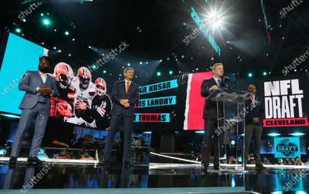 Cleveland Browns (L-R) Jarvis Landry, Bernie Kosar and Joe Thomas join NFL commissioner Roger Goodell on stage at the 2021 NFL Draft in Cleveland, Ohio