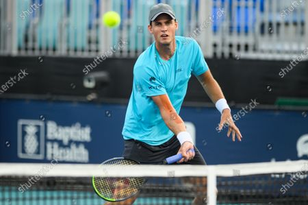 Vasek Pospisil of Canada hits a forehand during his loss to Mackenzie McDonald of the United States in the first round at the Miami Open on , on the grounds of Hard Rock Stadium in Miami Gardens, Florida