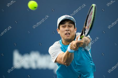 Stock Picture of Mackenzie McDonald of the United States reaches for a backhand during his victory over Vasek Pospisil of Canada in the first round at the Miami Open on , on the grounds of Hard Rock Stadium in Miami Gardens, Florida