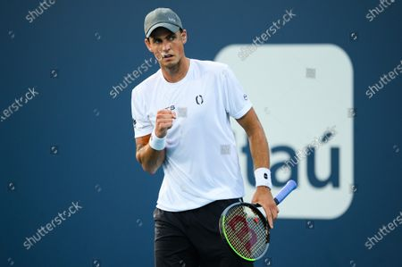 Vasek Pospisil of Canada reacts to a point during his loss to Mackenzie McDonald of the United States in the first round at the Miami Open on , on the grounds of Hard Rock Stadium in Miami Gardens, Florida