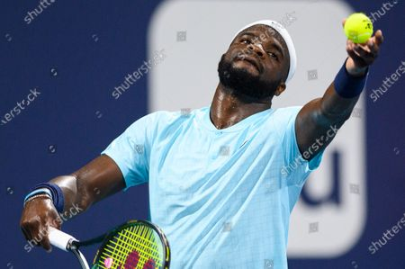 Frances Tiafoe of the United States serves the ball during his victory over Stefano Travaglia of Italy in the first round at the Miami Open on , on the grounds of Hard Rock Stadium in Miami Gardens, Florida