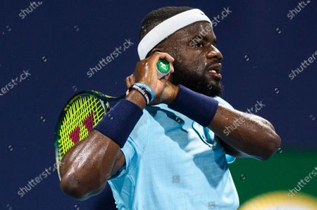 Frances Tiafoe of the United States hits a backhand during his victory over Stefano Travaglia of Italy in the first round at the Miami Open on , on the grounds of Hard Rock Stadium in Miami Gardens, Florida