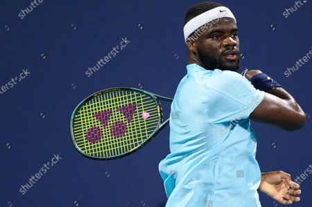Frances Tiafoe of the United States follows through a shot during his victory over Stefano Travaglia of Italy in the first round at the Miami Open on , on the grounds of Hard Rock Stadium in Miami Gardens, Florida