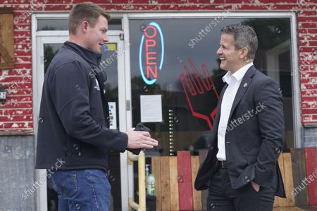 Rep. Adam Kinzinger, R-Ill., right, chats with Texas congressional candidate Michael Wood, in Arlington, Texas. Wood is considered the anti-Trump Republican Texas congressional candidate that Kinzinger has endorsed in the May 1st special election for the 6th Congressional District