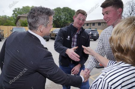 Rep. Adam Kinzinger, R-Ill., left, shakes hands with Grant Goodyear, right, as Texas congressional candidate Michael Wood, center, shakes hands with Linda Thomas, in Arlington, Texas. Wood is considered the anti-Trump Republican Texas congressional candidate that Kinzinger has endorsed in the May 1st special election for the 6th Congressional District