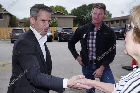 Stock Photo of Rep. Adam Kinzinger, R-Ill., left, shakes hands with Linda Thomas right, as Texas congressional candidate Michael Wood looks, in Arlington, Texas. Wood is considered the anti-Trump Republican Texas congressional candidate that Kinzinger has endorsed in the May 1st special election for the 6th Congressional District