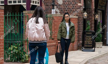 Stock Image of Coronation Street - Ep 10317 Wednesday 5th May 2021 - 1st Ep Devastated Asha Alahan, as played by Tanisha Gorey, heads home, meeting Amy Barlow, as played by Elle Mulvaney, on her way back to the street.