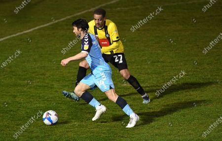 Wesley Hoolahan of Cambridge United and Jay Williams of Harrogate Town