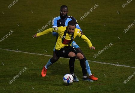 Jay Williams of Harrogate Town and Hiram Boateng of Cambridge United