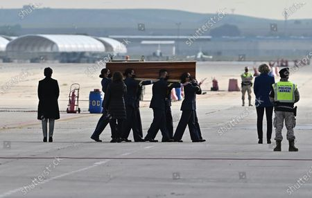 Stock Picture of Members of the army carry a coffin as the bodies of slain Spanish journalists David Beriain Amatriain and Roberto Fraile, and president of the anti-poaching group Chengeta Wildlife, Irish Rory Young, arrive at the Torrejon de Ardoz military airport in Madrid, Spain, 30 April 2021. They were killed on 27 April in Burkina Faso while working on a documentary about poaching in the Pama area of the country.