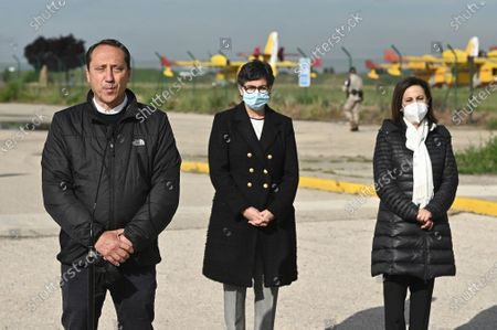 Alfonso Bauluz (L), secretary-general of the Spanish branch of Reporters Without Borders, Spanish Defense Minister Margarita Robles (R) and Foreing Affairs Minister Arancha Gonzalez Laya (C) attend the ceremony for the repatriation of the bodies of slain Spanish journalists David Beriain Amatriain and Roberto Fraile, and president of the anti-poaching group Chengeta Wildlife, Irish Rory Young, at the Torrejon de Ardoz military airport in Madrid, Spain, 30 April 2021. They were killed on 27 April in Burkina Faso while working on a documentary about poaching in the Pama area of the country.