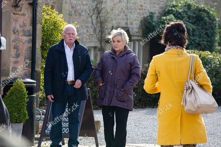 Stock Image of Emmerdale - Ep 9039 Wednesday 5th May 2021 Brenda Hope, as played by Lesley Dunlop, watched by Eric Pollard, as played by Chris Chittell, accuses Faith Dingle, as played by Sally Dexter, of stealing her brooch but has she got it wrong?