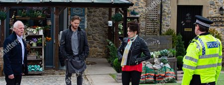 Emmerdale - Ep 9044 Tuesday 11th May 2021 Pollard's, as played by Chris Chittell, stunned when the police arrive and charge him for Aaron Dingle's injuries, watched by David Metcalfe, as played by Matthew Wolfenden, and Faith Dingle, as played by Sally Dexter.