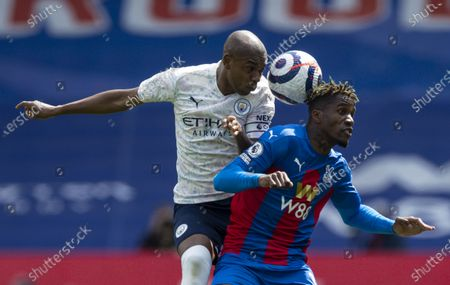Fernandinho of Manchester City and Wilfried Zaha of Crystal Palace