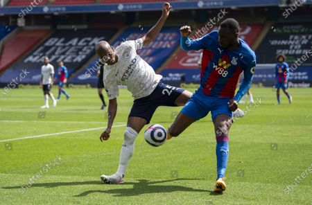 Fernandinho of Manchester City and Christian Benteke of Crystal Palace battle for the ball