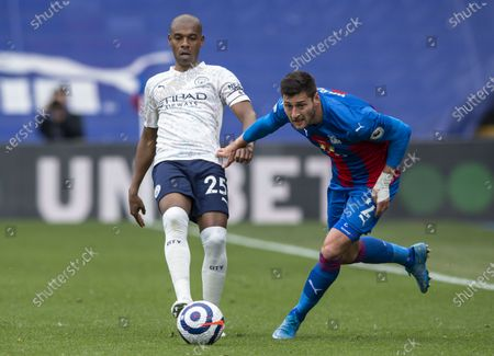 Fernandinho of Manchester City under pressure from Joel Ward of Crystal Palace