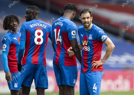 Luka Milivojevic of Crystal Palace lines up in the defensive wall