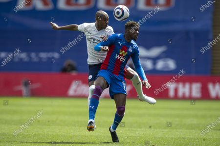 Fernandinho of Manchester City and Wilfried Zaha of Crystal Palace battle for the ball