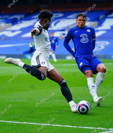 Josh Maja of Fulham attempts to cross past Thiago Silva of Chelsea