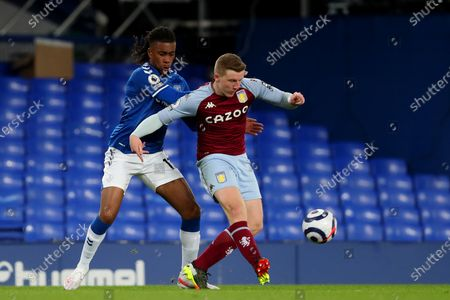 Alex Iwobi of Everton and Matt Targett of Aston Villa