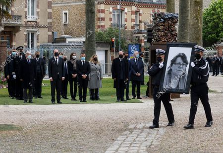 French police officers carry the portrait of murdered Stephanie Monferme, a mother and local police employee, as French Prime Minister Jean Castex, President of the French Senate Gerard Larcher and French ministers stand during a remembrance gathering, in Rambouillet, a suburb southwest of Paris, France, 30 April 2021. A Tunisian man who on 23 April stabbed to death the police employee, had watched jihadist propaganda videos just before the attack, France's anti-terror prosecutor said on 25 April 2021.