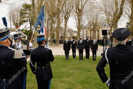 President of the French Senate Gerard Larcher (L), French Prime Minister Jean Castex (C) and French Interior Minister Gerald Darmanin (R) pay homage to slain police employee Stephanie Monferme during a remembrance ceremony in Rambouillet, a suburb southwest of Paris, France, 30 April 2021. A Tunisian man who on 23 April stabbed to death the police employee, had watched jihadist propaganda videos just before the attack, France's anti-terror prosecutor said on 25 April 2021.