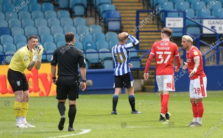 Keiren Westwood goalkeeper for Sheffield Wednesday protests to referee Tim Robinson after he awarded a penalty kick for his foul on Anthony Knockaert of Nottingham Forest